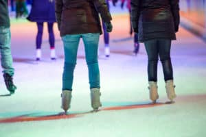People ice skating at night in Vienna, Austria. Winter.